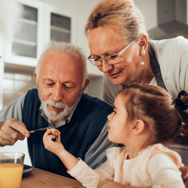 grandfather and grandmother with preschool child