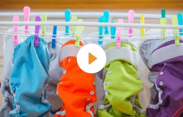 spraying a cloth diaper